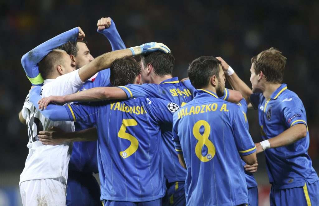 BATE Borisov's players celebrate their victory over Athletic Bilbao in the Champions League soccer match in Borisov